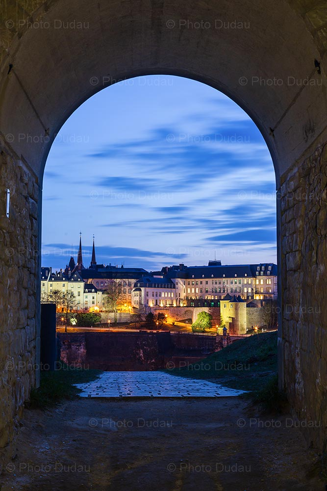 Luxembourg city seen from tunnel at night