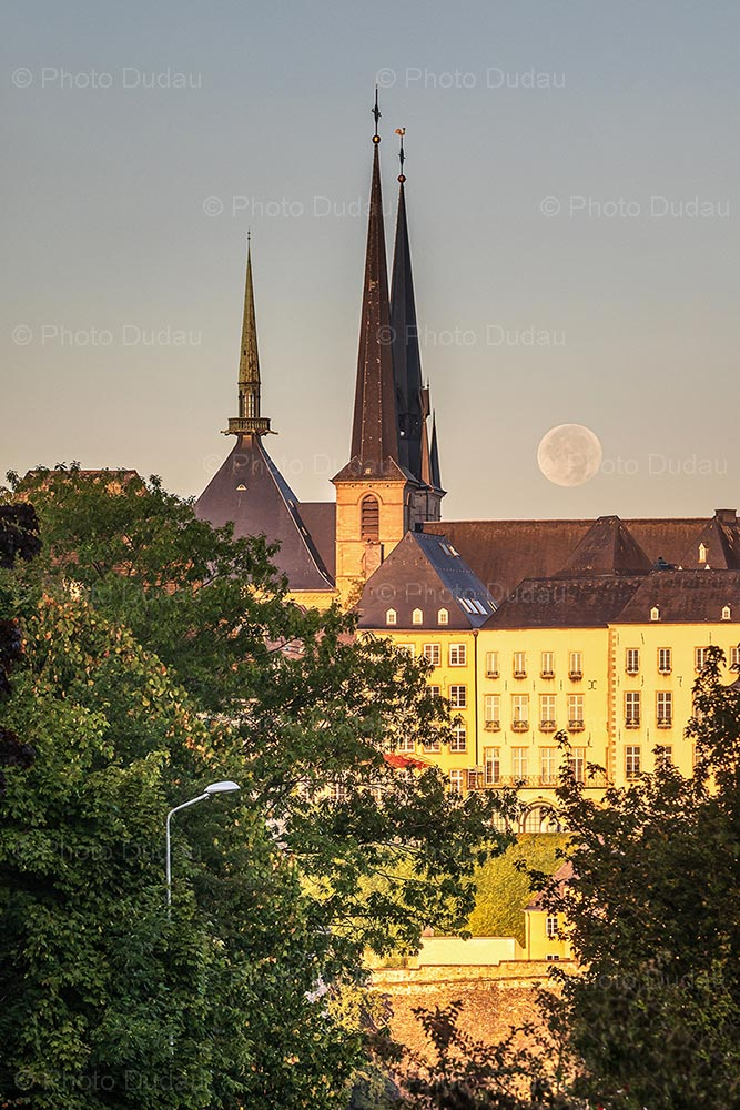 Moonset during sunrise in Luxembourg