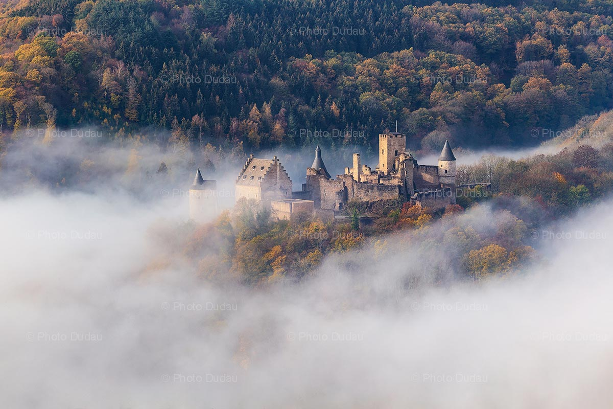 Bourscheid Castle in fog during autumn
