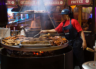 sausages, steaks and burgers on grill at Schueberfouer