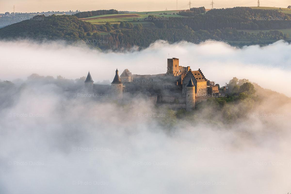 Bourscheid Castle in Luxembourg in fog