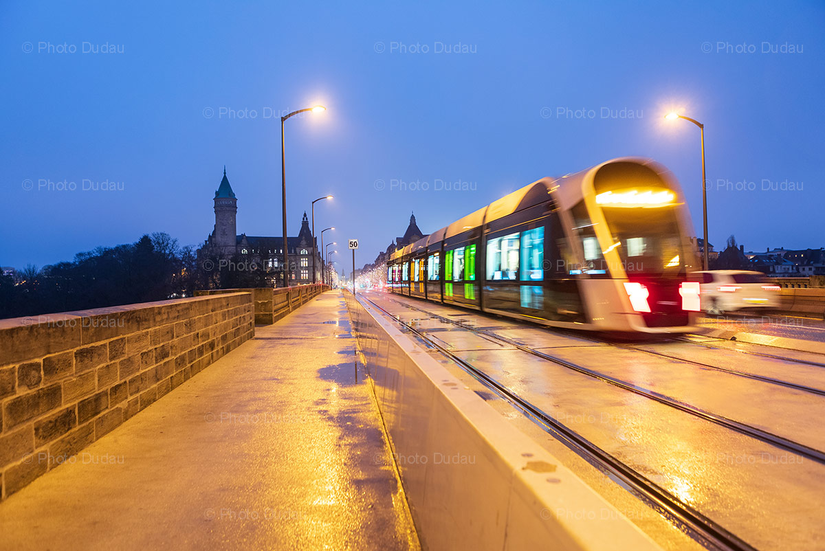 Tram on Pont Adolphe at night